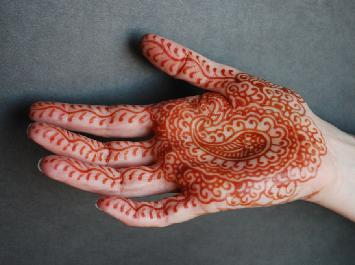 7aa5b28df2ac4 Natural Henna stains in various shades of red, orange, brown, etc...Skin  type affects colour. There are products that call themselves black henna.